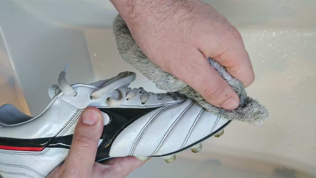 cleaning your football boots with a damp cloth